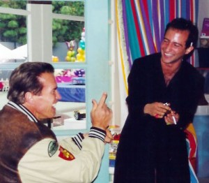 arnold catches simon red handed during a magic trick at schwarzenegger residence_maria shriver and patrick and christina family